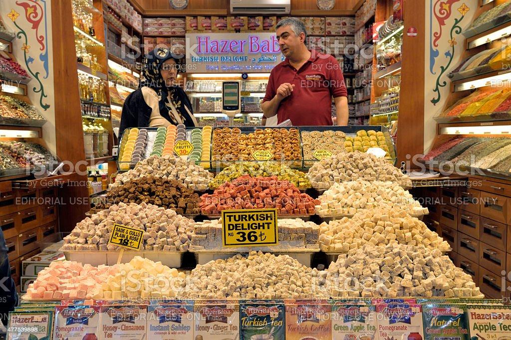 Turkish delight seller at Gran Bazaar, Istanbul Turkey. stock photo