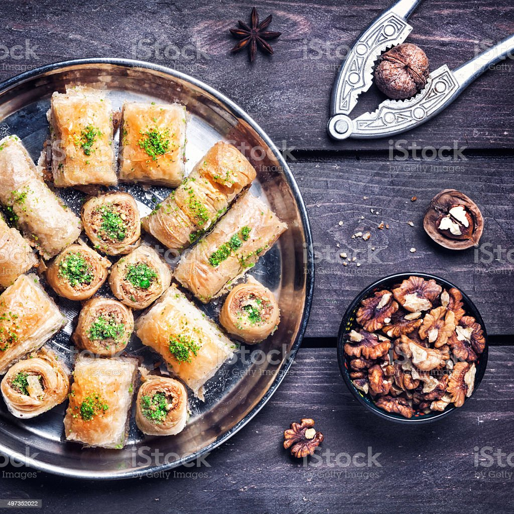 Turkish delights baklava on wooden table stock photo