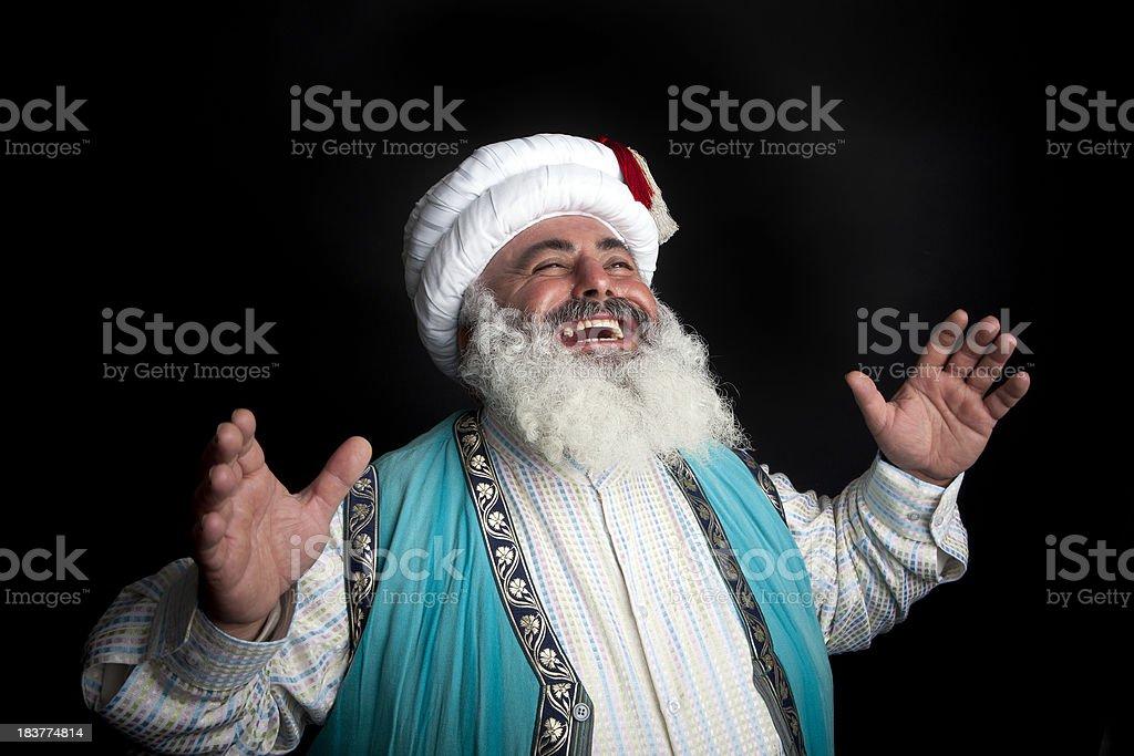 Turkish Dervish laughing. stock photo