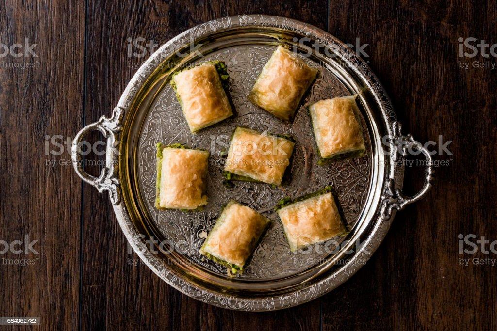 Turkish Dessert Baklava with pistachio on silver tray. stock photo