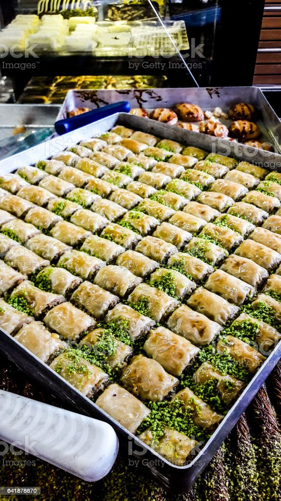 Turkish dessert baklava with pistachio powder. stock photo