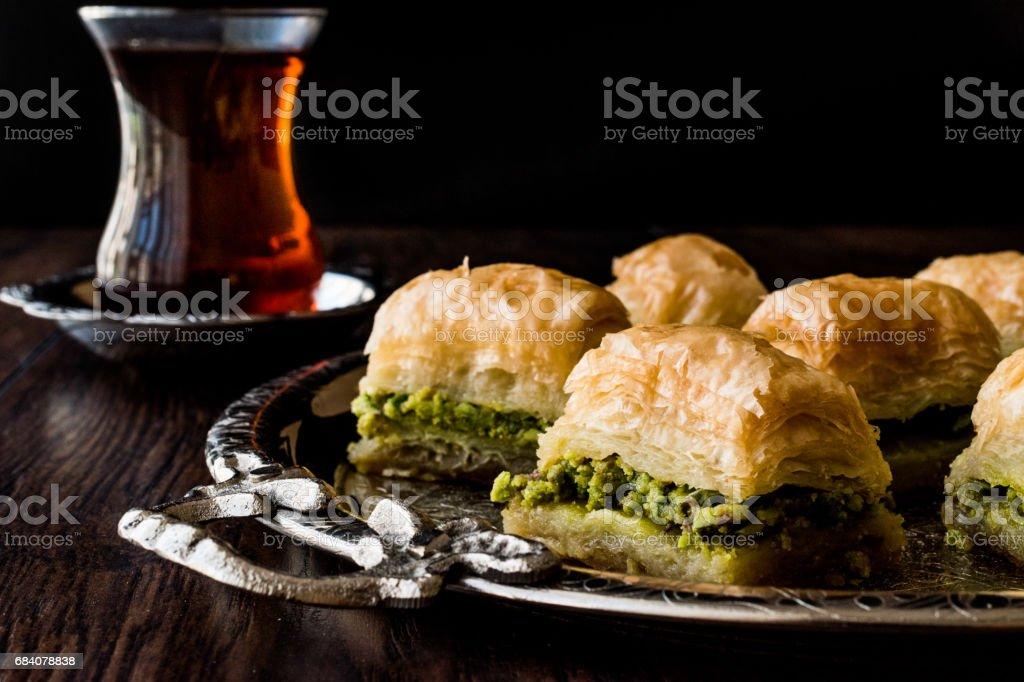 Turkish Dessert Baklava with tea on silver tray. stock photo