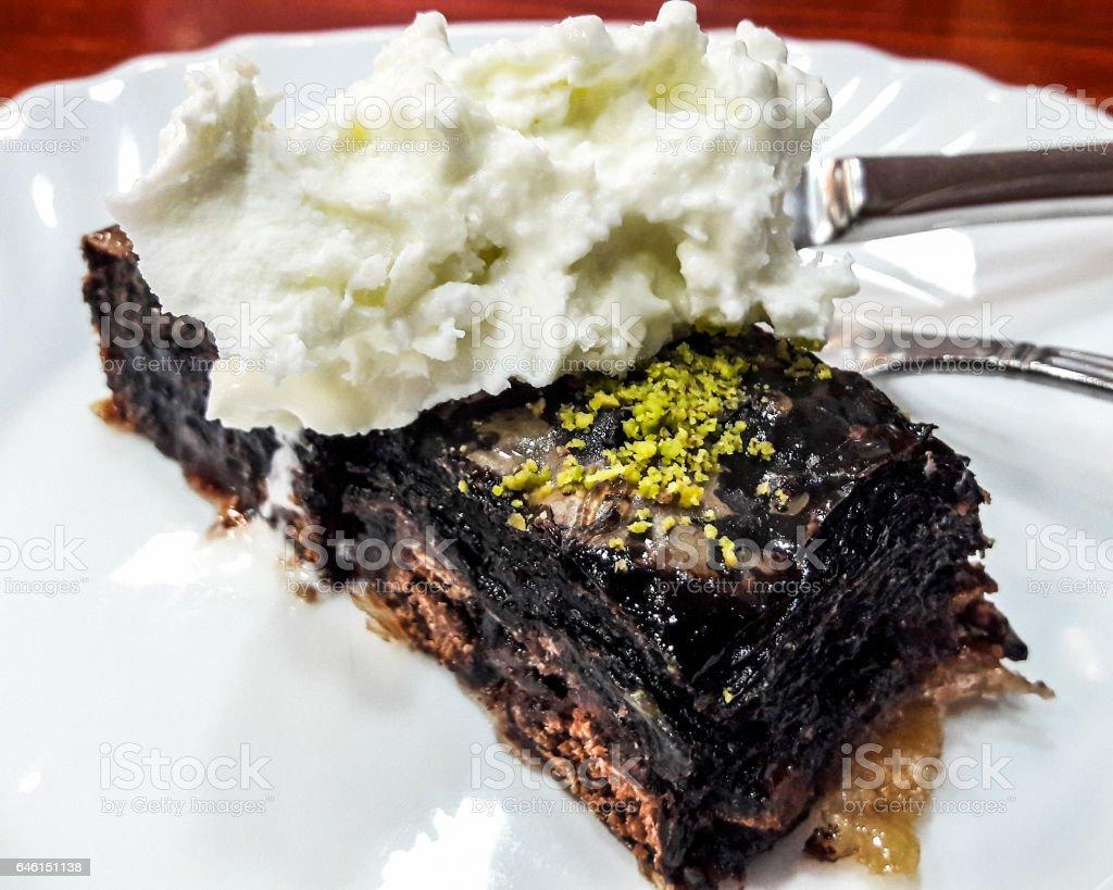 Turkish Dessert Chocolate Baklava with Kaymak or Cream. stock photo