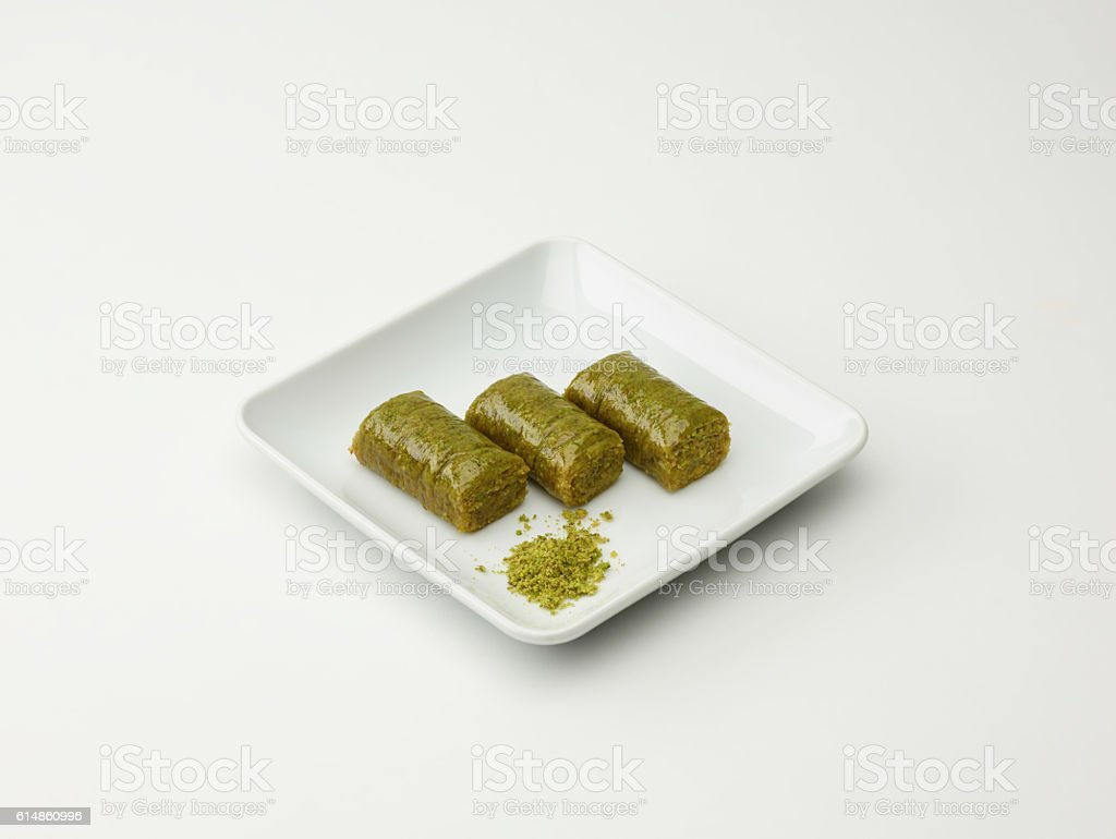 Turkish Dessert Fistikli Sarma On White stock photo