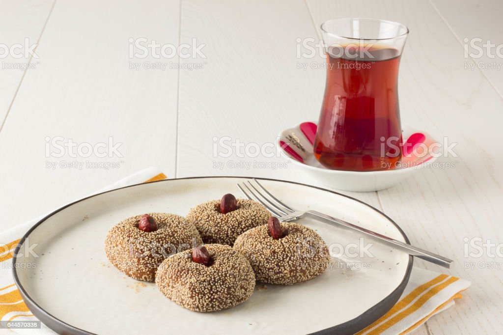 Turkish dessert Sekerpare with poppy seeds stock photo