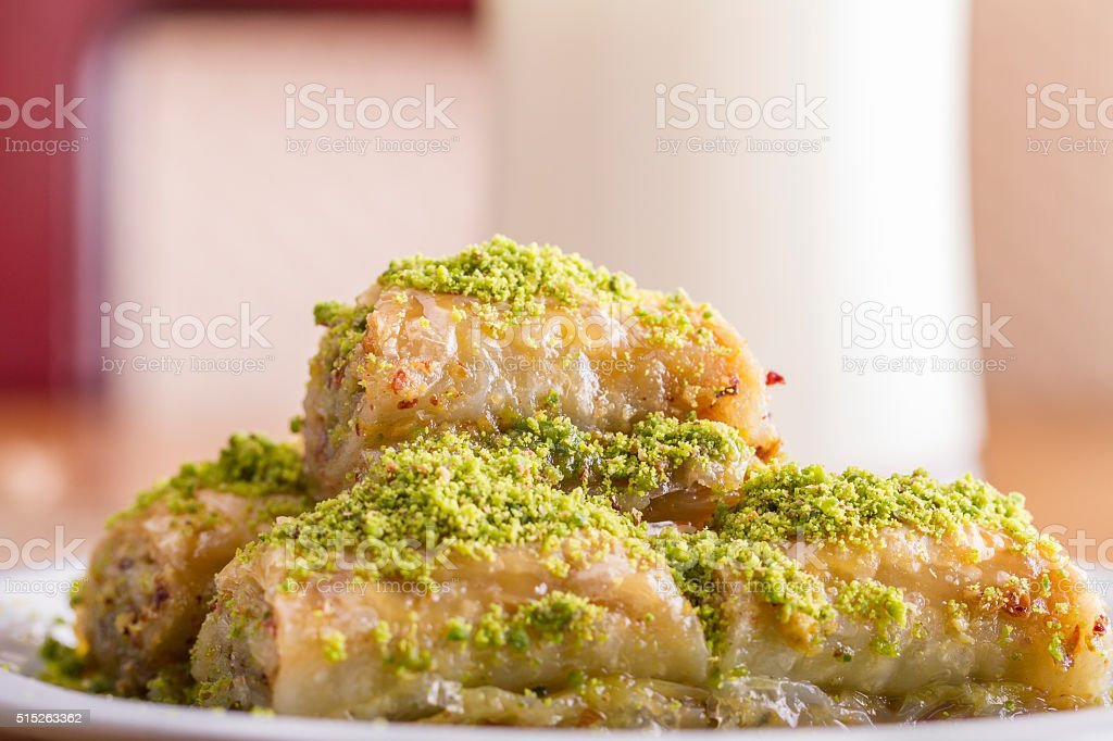 Turkish dessert sutlu nuriye with pistachio and milk stock photo