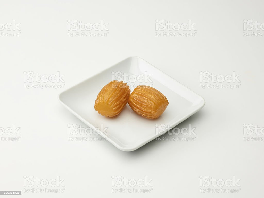 Turkish Dessert Tulumba On White stock photo