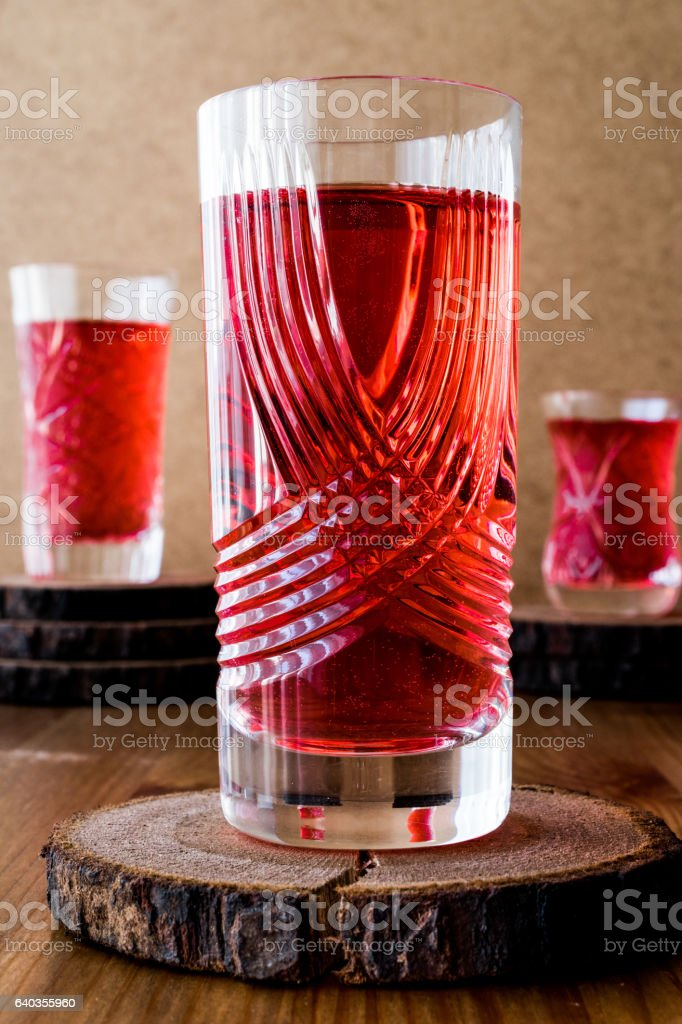 Turkish Drink Rose sherbet or Cranberry Serbet in crystal glass. stock photo