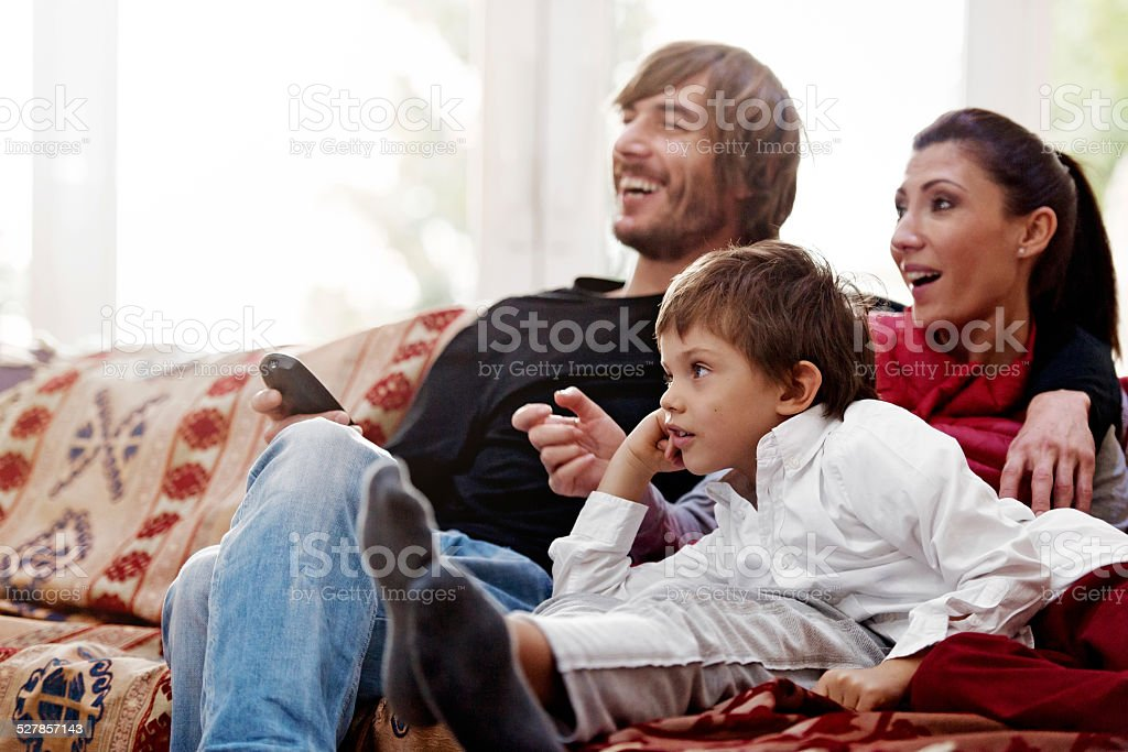 Turkish family watching tv stock photo
