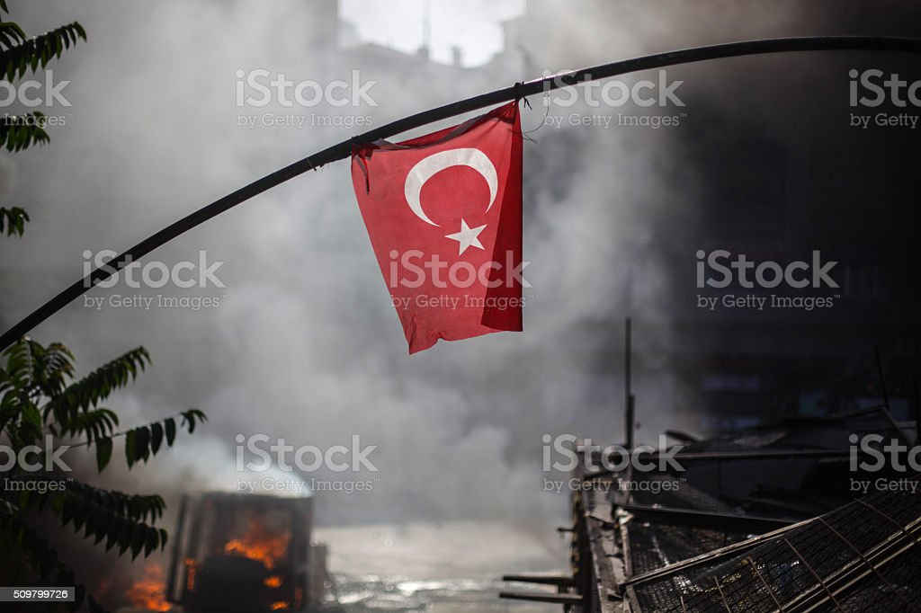 Turkish flag amidst riot stock photo
