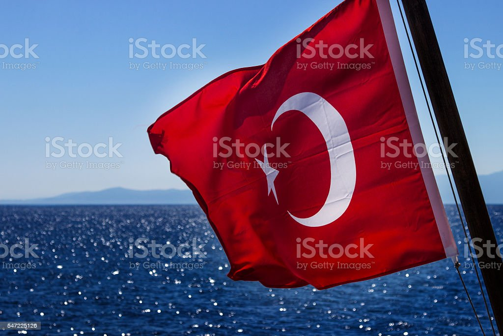 Turkish Flag in the sea stock photo