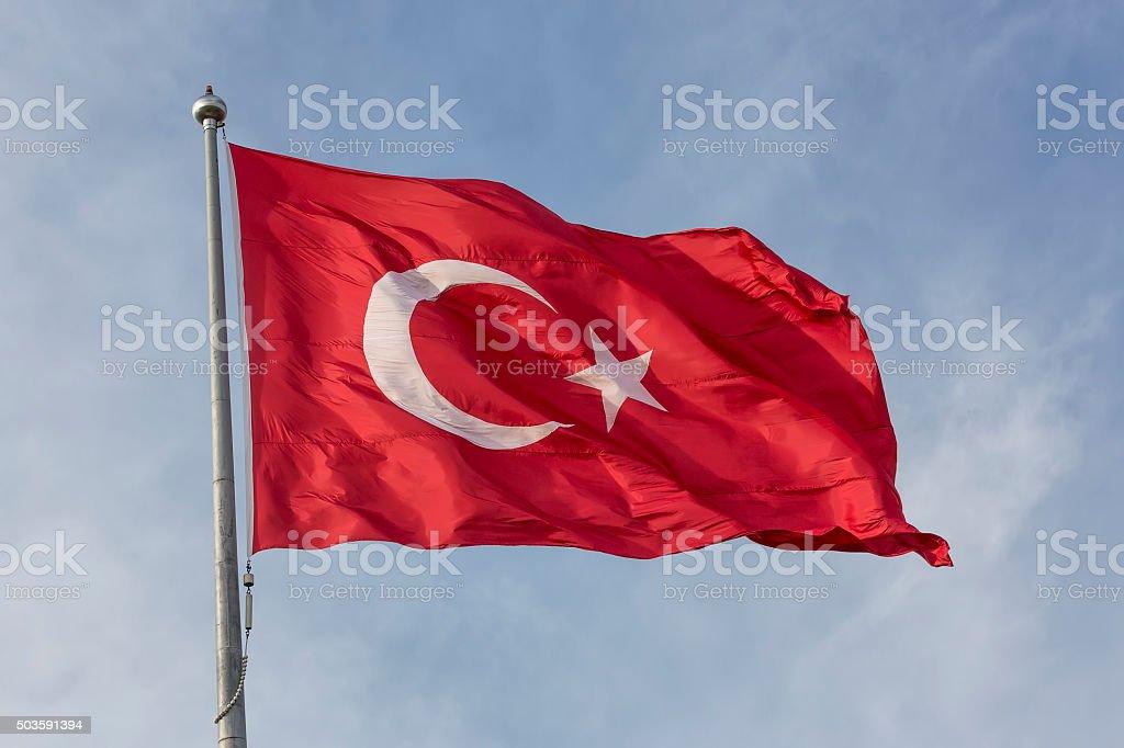 Turkish flag on sky background stock photo
