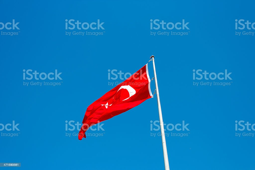Turkish flag waving in blue sky royalty-free stock photo