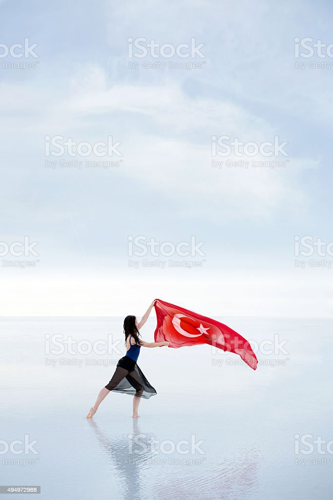 Turkish flag waving in the wind outdoors stock photo
