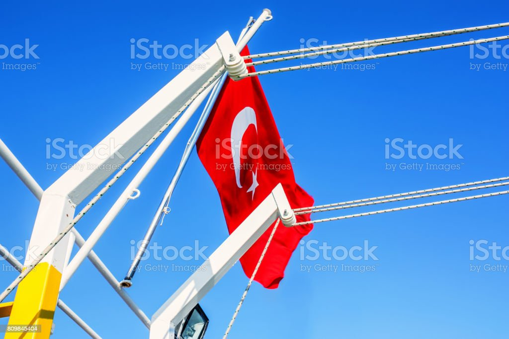 Turkish flag waving in the wind stock photo