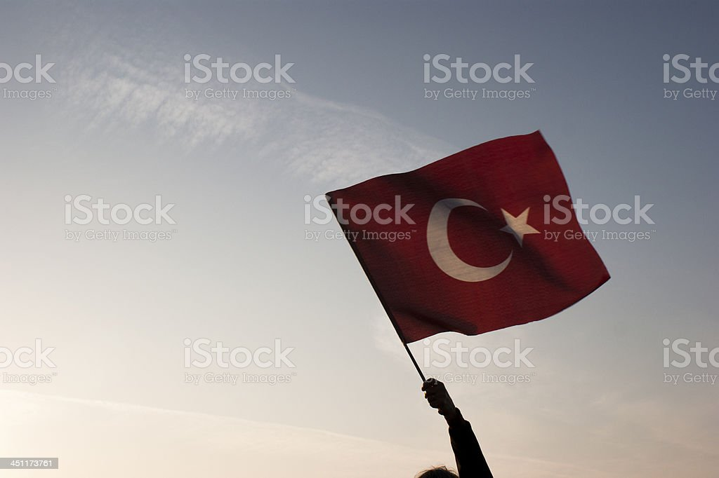 Turkish flag waving through sky stock photo