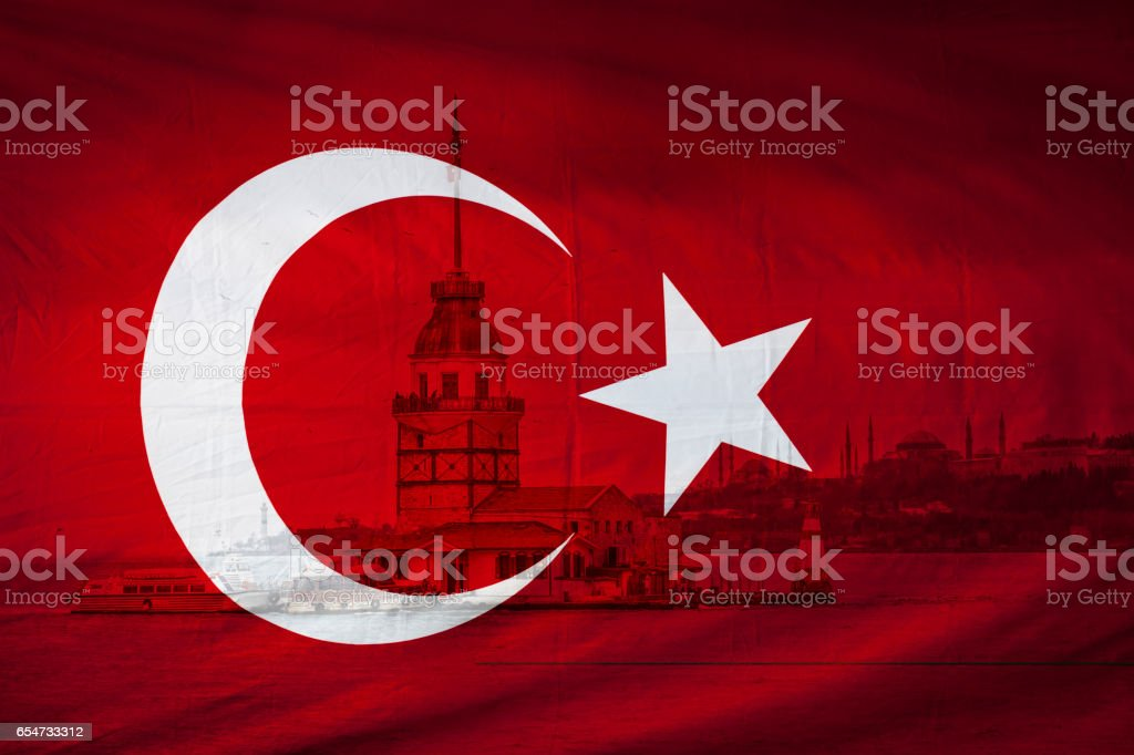 Turkish flag with view of The Istanbul Maidens Tower in backgrou stock photo
