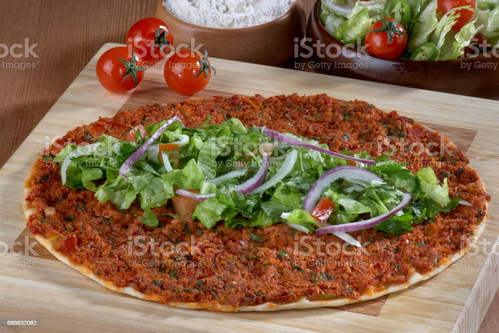 Turkish Food: lahmacun closeup on a wooden table. Horizontal stock photo