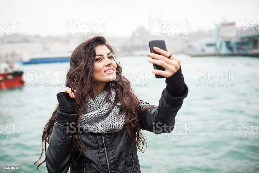 Turkish Girl Making A Selfie At The Port stock photo