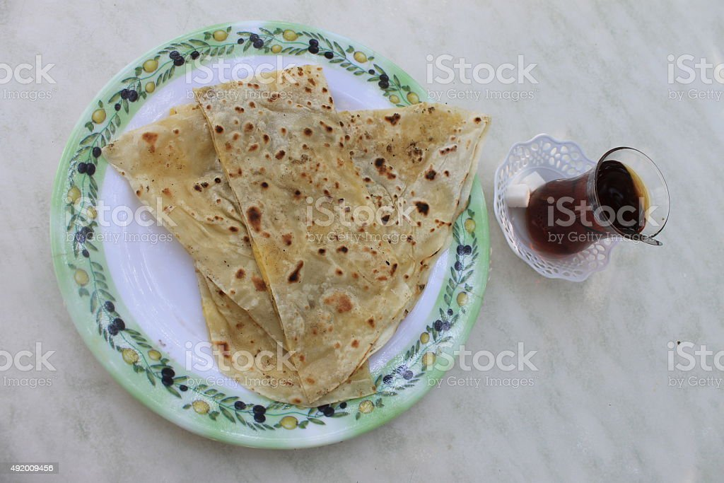 Turkish gozleme tortillas stuffed with potatoes and tea stock photo