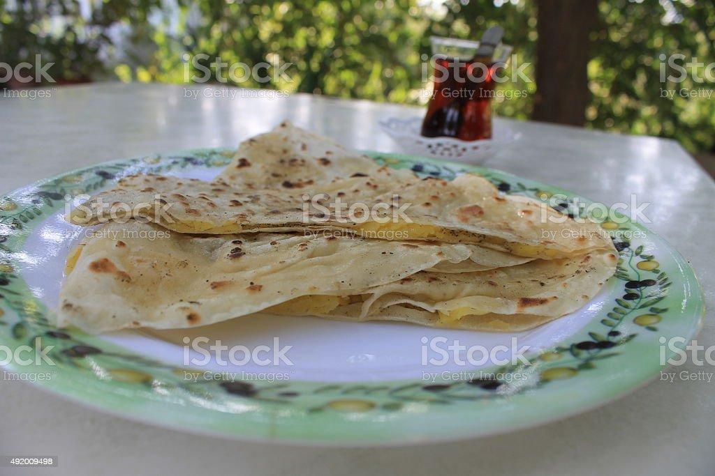 Turkish gozleme tortillas stuffed with potatoes and tea stock photo