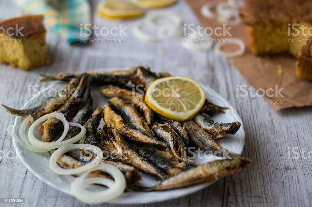 Turkish Hamsi Tava with cornbread / Fried Anchovies stock photo