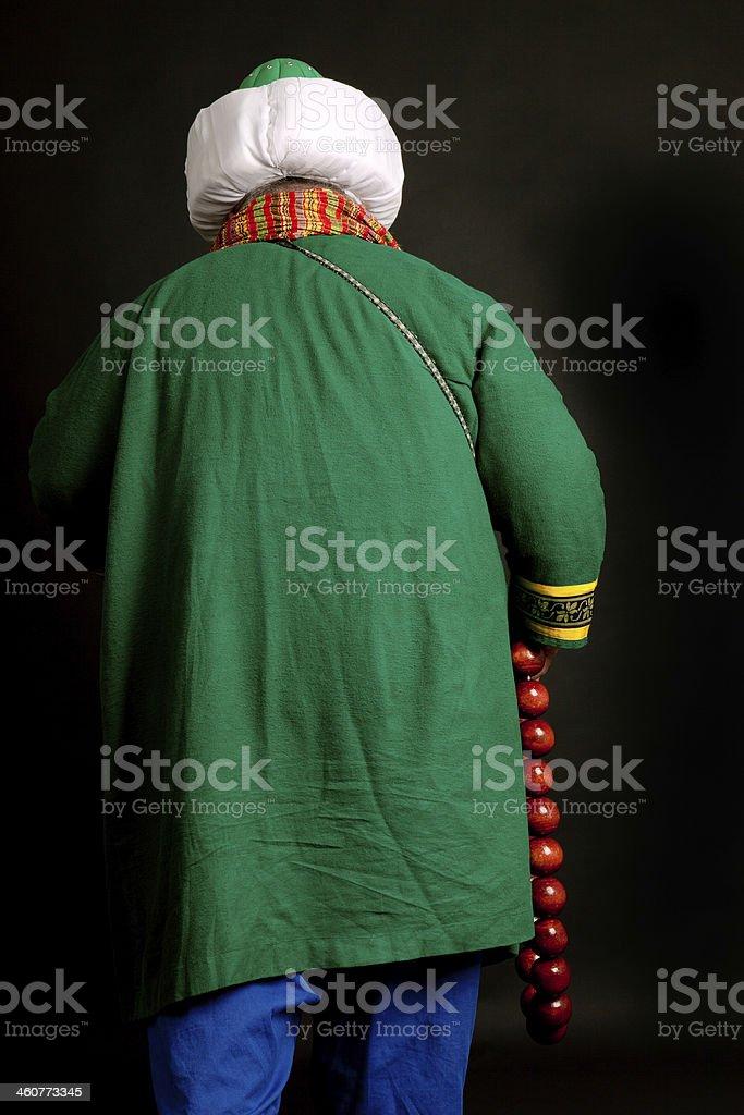 Turkish Imam walking stock photo