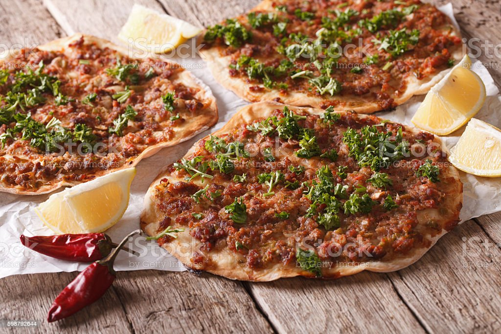 Turkish lahmacun closeup on a wooden table. Horizontal stock photo