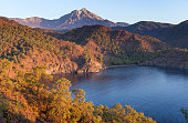 Turkish landscape with Olympos mountain, beach and green forest