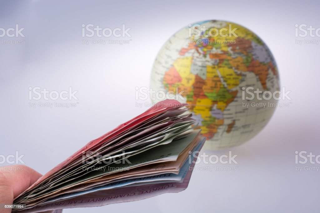 Turkish Lira banknotes by the side of a model globe stock photo