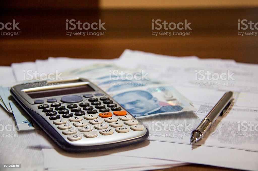 turkish lira,  calculator and pen stock photo
