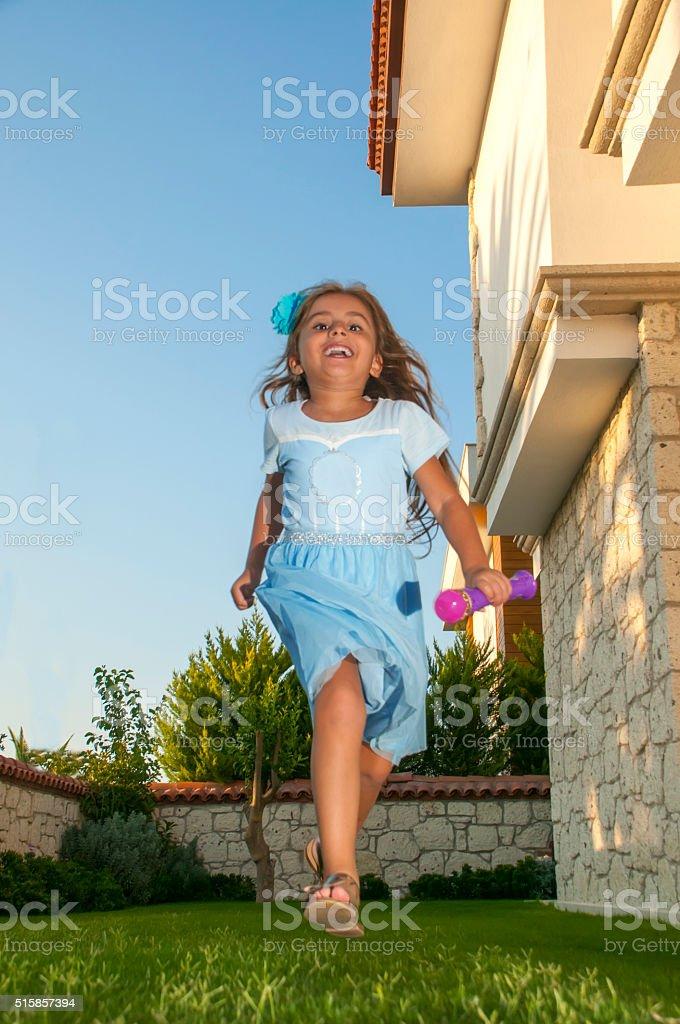 Turkish little girl enjoying at holiday stock photo