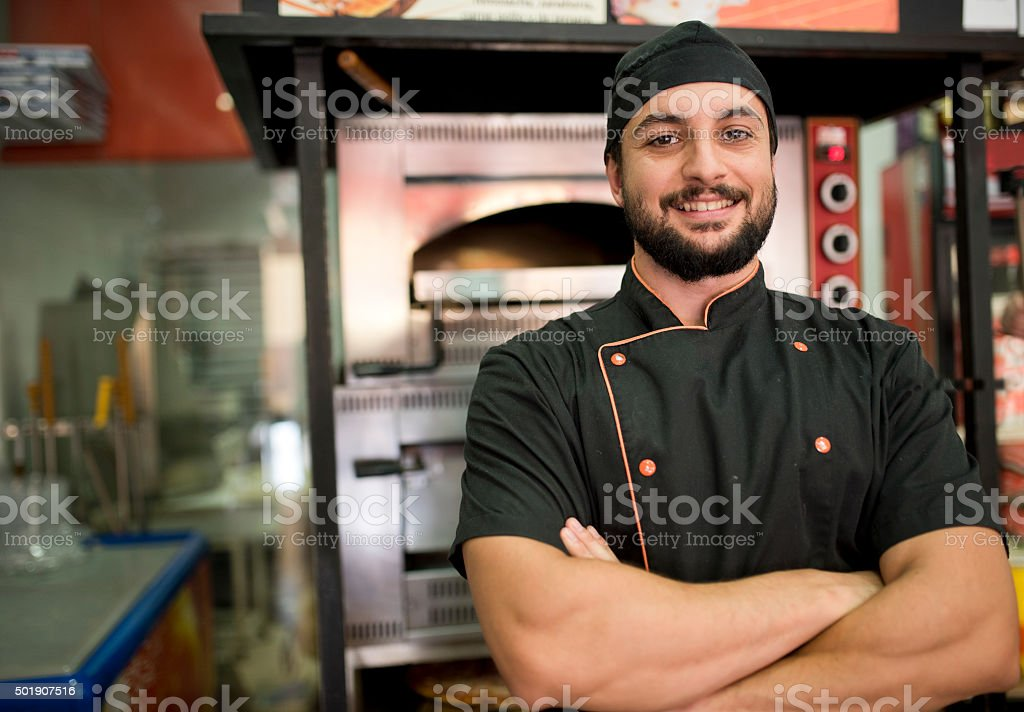 Turkish man posing near to oven stock photo