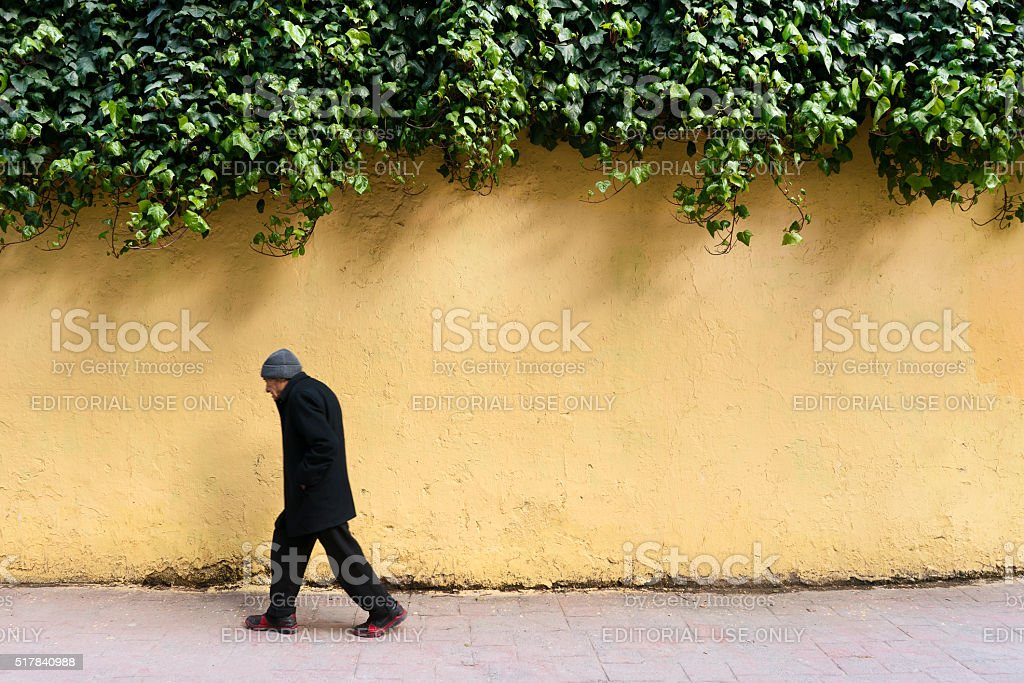 Turkish  man walking in cihangir street,İstanbul stock photo