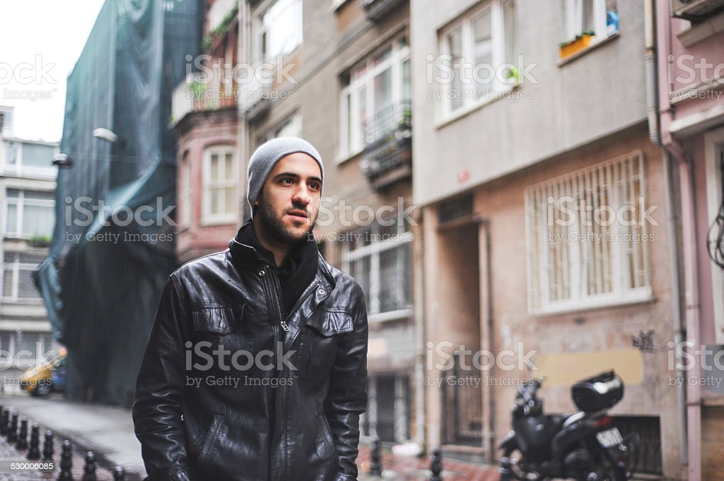 Turkish Man walking on the street stock photo