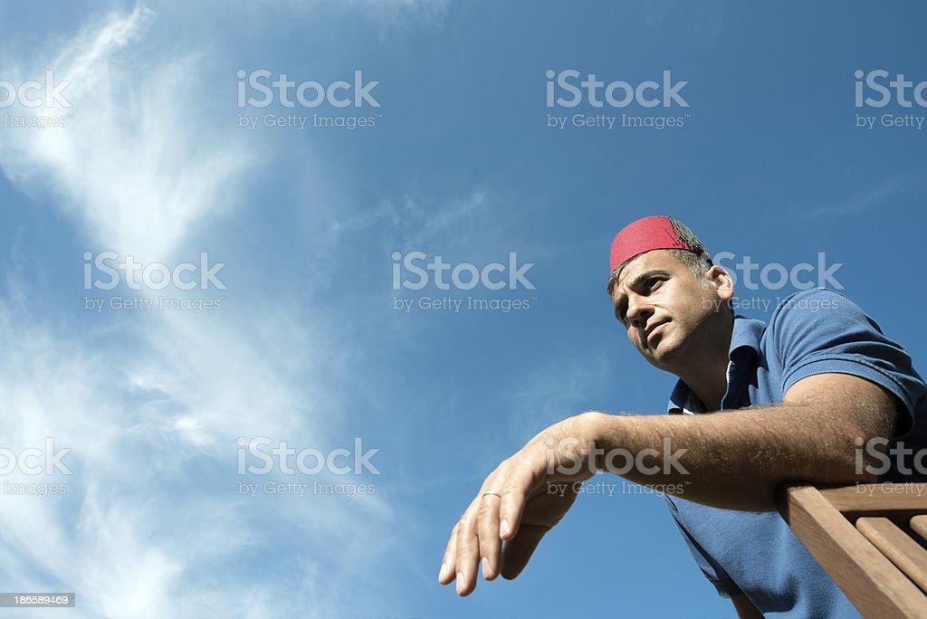 Turkish man wearing a fez royalty-free stock photo
