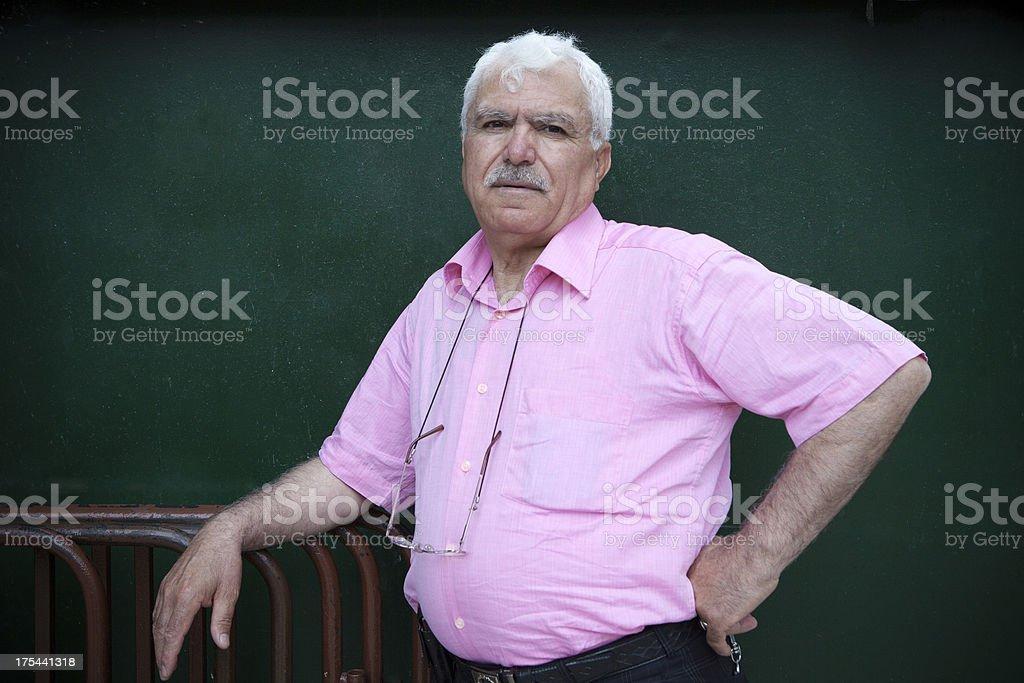 Turkish man wearing pink color shirt. royalty-free stock photo