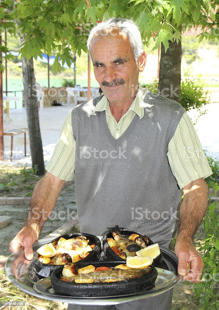 turkish man with food in restaurant royalty-free stock photo