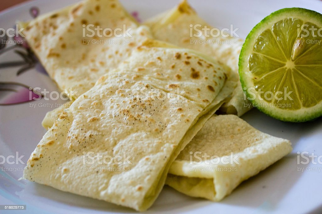 Turkish pancakes with lime stock photo