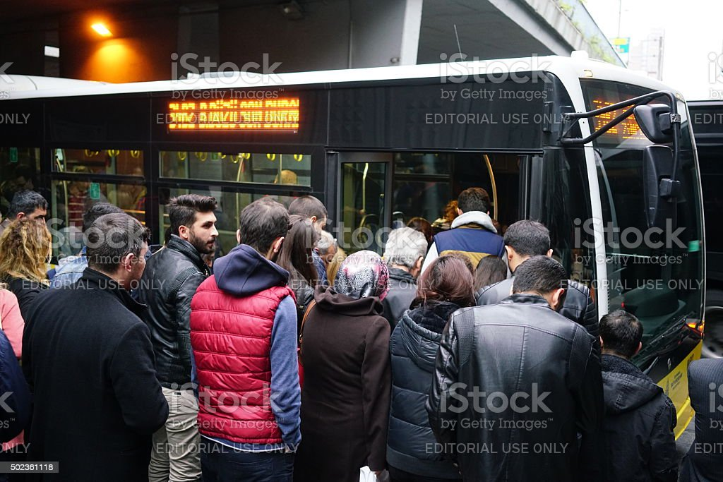 Turkish people boarding a metrobus stock photo