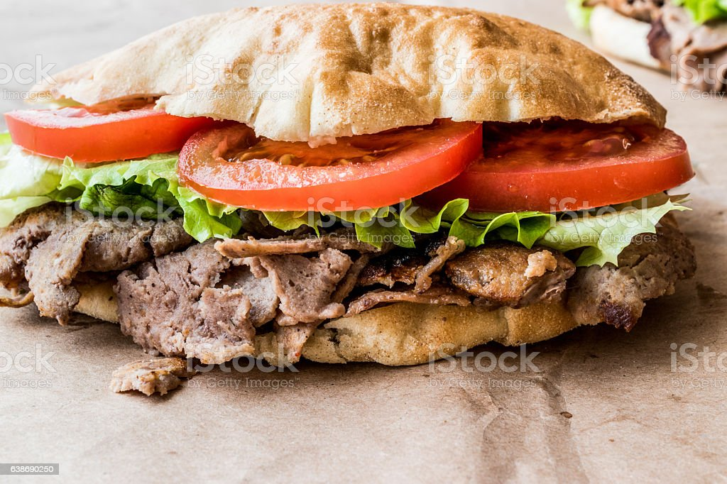 Turkish Pide Doner Sandwich with greens and tomatoes. stock photo