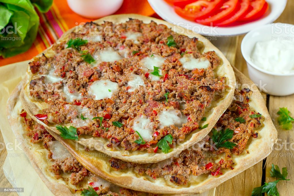 Turkish pizza Lahmajoun Lahmacun with ground beef stock photo