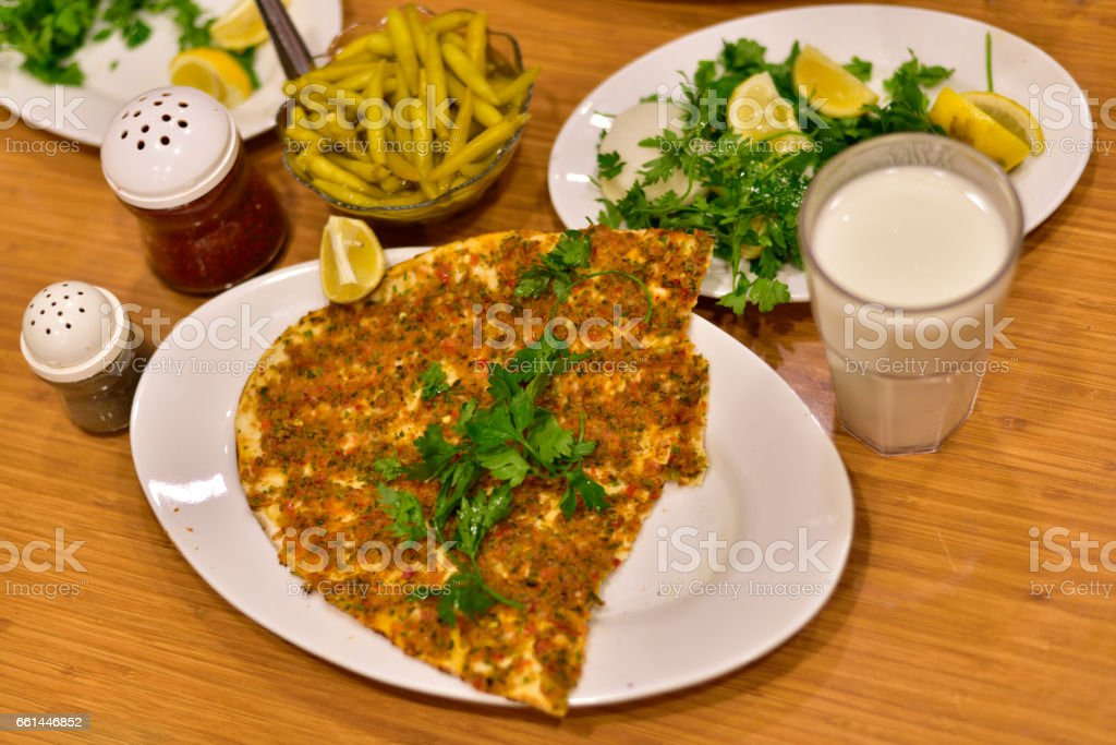 Turkish pizza which name is lahmacun in a famous local restaurant in Gaziantep, Turkey stock photo