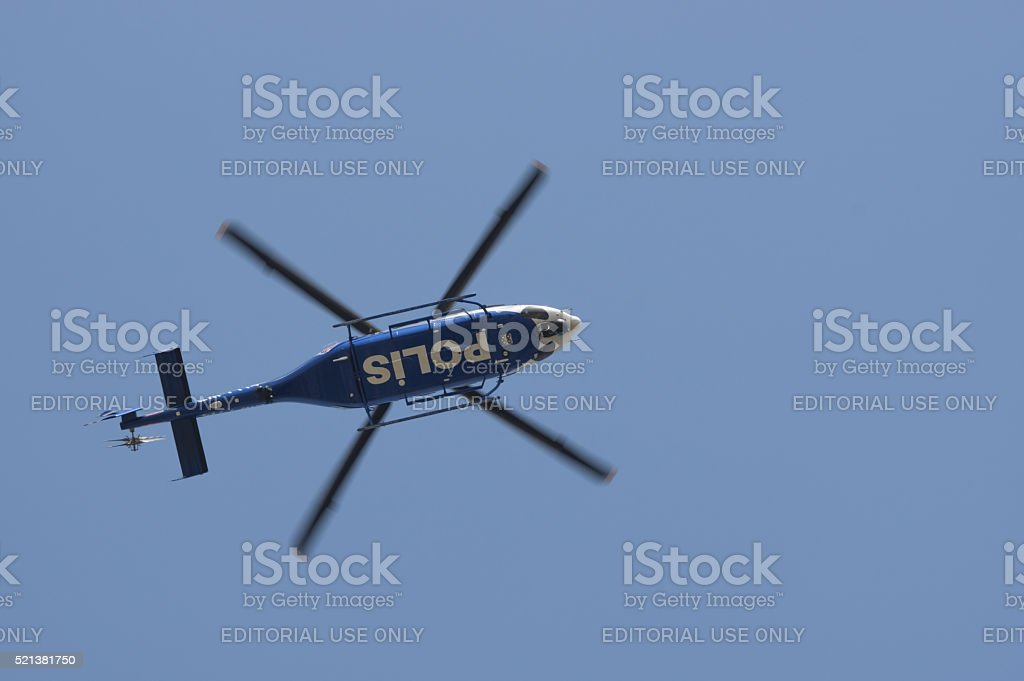 Turkish police helicopter flying over the city. stock photo