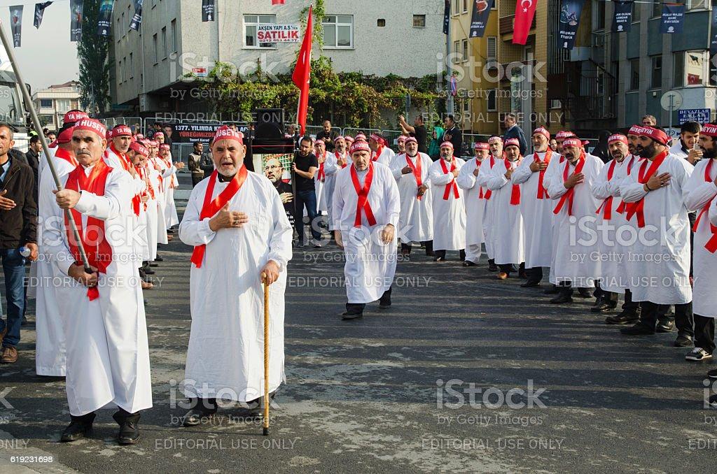 Turkish Shia men mourning day of Ashura stock photo
