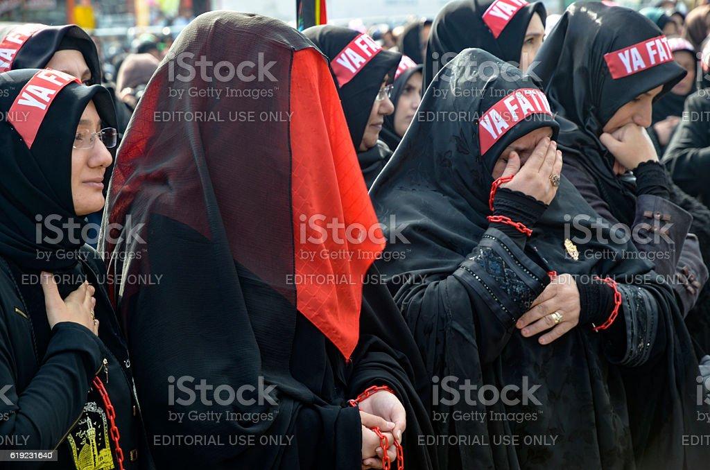 Turkish Shia women mourn during an Ashura procession in Istanbul stock photo