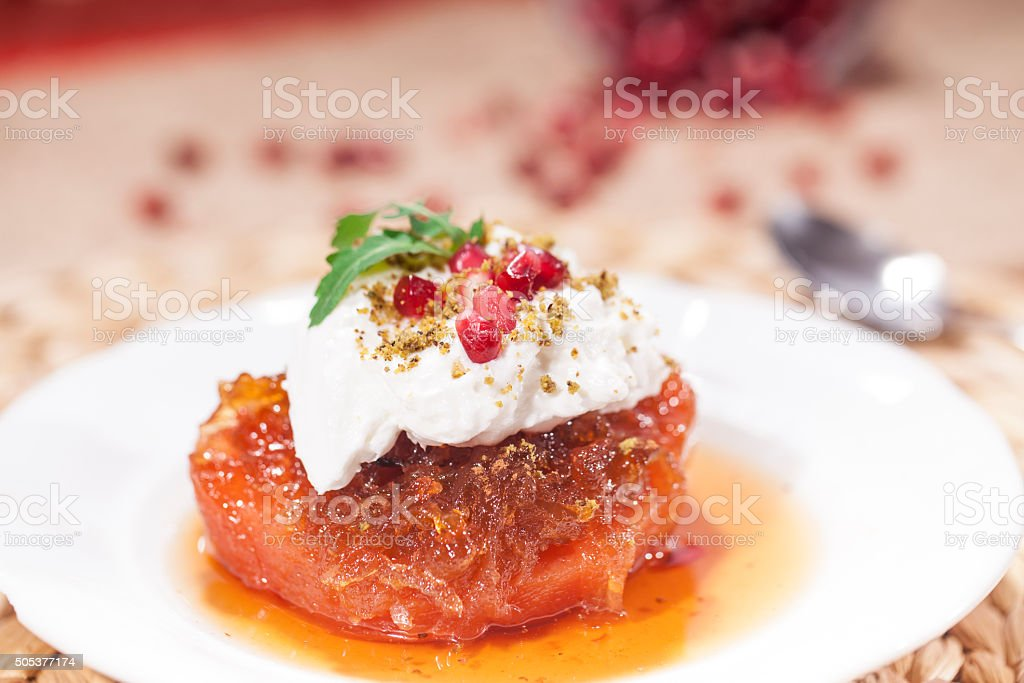 Turkish Speciel Traditional Quince Dessert with Cream on Burlap Background stock photo