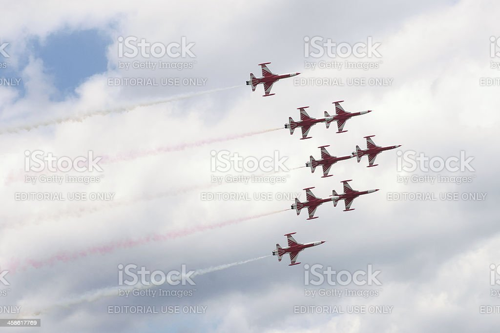 Turkish Stars aerobatic team against sky with clouds stock photo