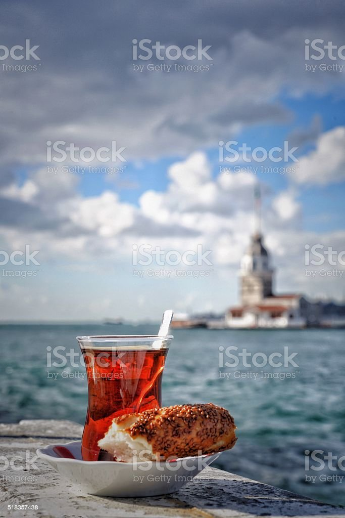 turkish tea and bagel against sea stock photo