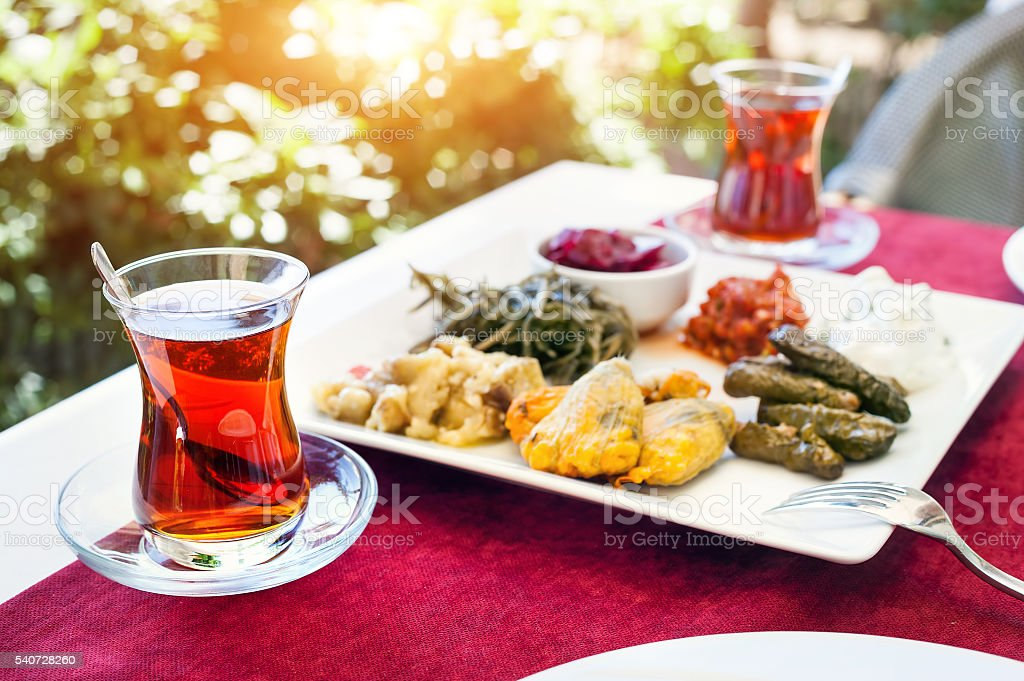 Turkish tea and meze in restaurant stock photo